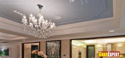Chandelier on gray painted ceiling