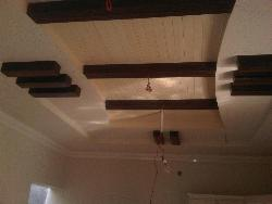 POP with wood ceiling design
