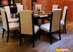 Round table and hardwood floor in dining area