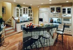 White colored kitchen with white colored appliances