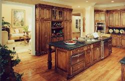 Rustic style kitchen cabinets and sink over the granite counter top