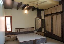 POP and wooden ceiling in Bedroom with wooden wardrobes