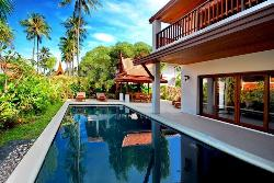Simple spacious swimming pool exterior elevation of the house.