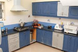 White and blue cabinets in kitchen
