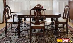 4 seater wooden dining with minimal carving