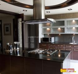 Kitchen design with island in steel  and wood