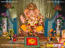 Ganpati decoration with coloured cloth and decoration string curtains