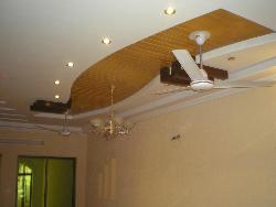 Wooden ceiling design with ceiling fan