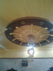 false ceiling design with round around the chandelier lights by maqbool interior