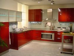 kitchen with glossy red laminates, frosted glass cabinets with steel finish chimney