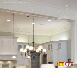 9 small lamps in hanging chandelier over the dining