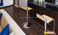Hardwood flooring with steel strips for open kitchen and living room