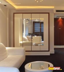 Looking mirror and white colored wood style for wardrobes