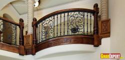 Iron grill with carved wooden balustrades
