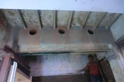 Brickwall kitchen chimney outlet pipeline after making holes/core cutting work