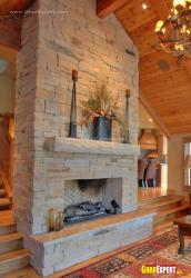 fireplace unit on stone cladded wall