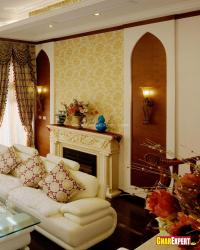 Highlighted golden petal wallpaper on fireplace wall