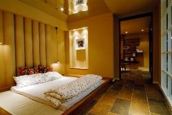 Master bedroom platform bed and lighting design