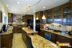 Kitchen Counter Top in Marble and the Lighting is also Suitable for Cooking