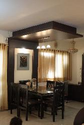 a dining space and wooden ceiling design