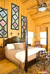 Bedroom with wooden walls and wooden ceiling effect