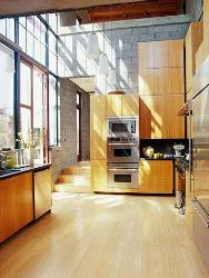 Wooden unit for appliances in kitchen. Wooden finish cabinet. Wooden Flooring. Hanging Kitchen Light Fixtures