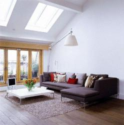 Contemporary Living Room Natural Lighting with skylights and large windows. Furniture for living room