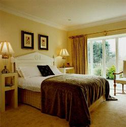 Cozy Bedroom Lighting, large windows with window curtains and carpet flooring