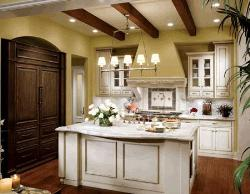 White cabinets with white marble counter top, Task lighting over the kitchen sink, wooden flooring and wooden ceiling in kitchen