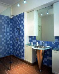 Tile Floor and wall tiles in Bathroom. Steel finish bathroom sink