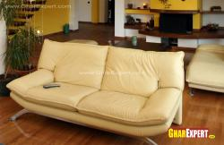 Beige colored 2 seater sofa for living room