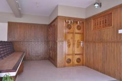 Wooden cladding on Wall with Decorative door