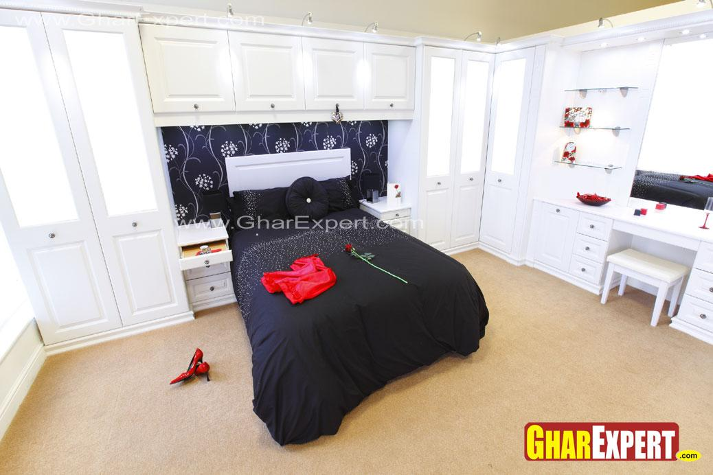 bedroom with white colored war....
