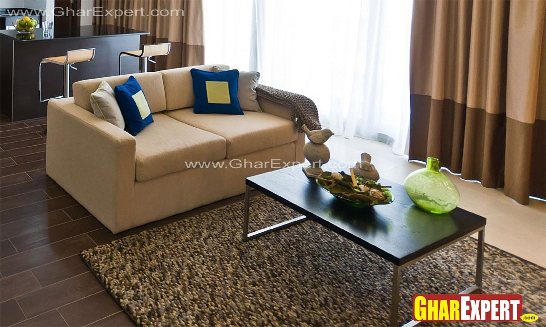 Upholstered sofa and wooden ta....