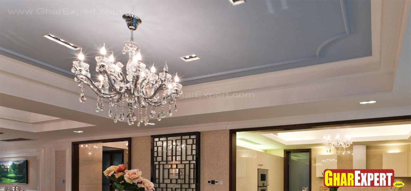 Chandelier on gray painted cei....