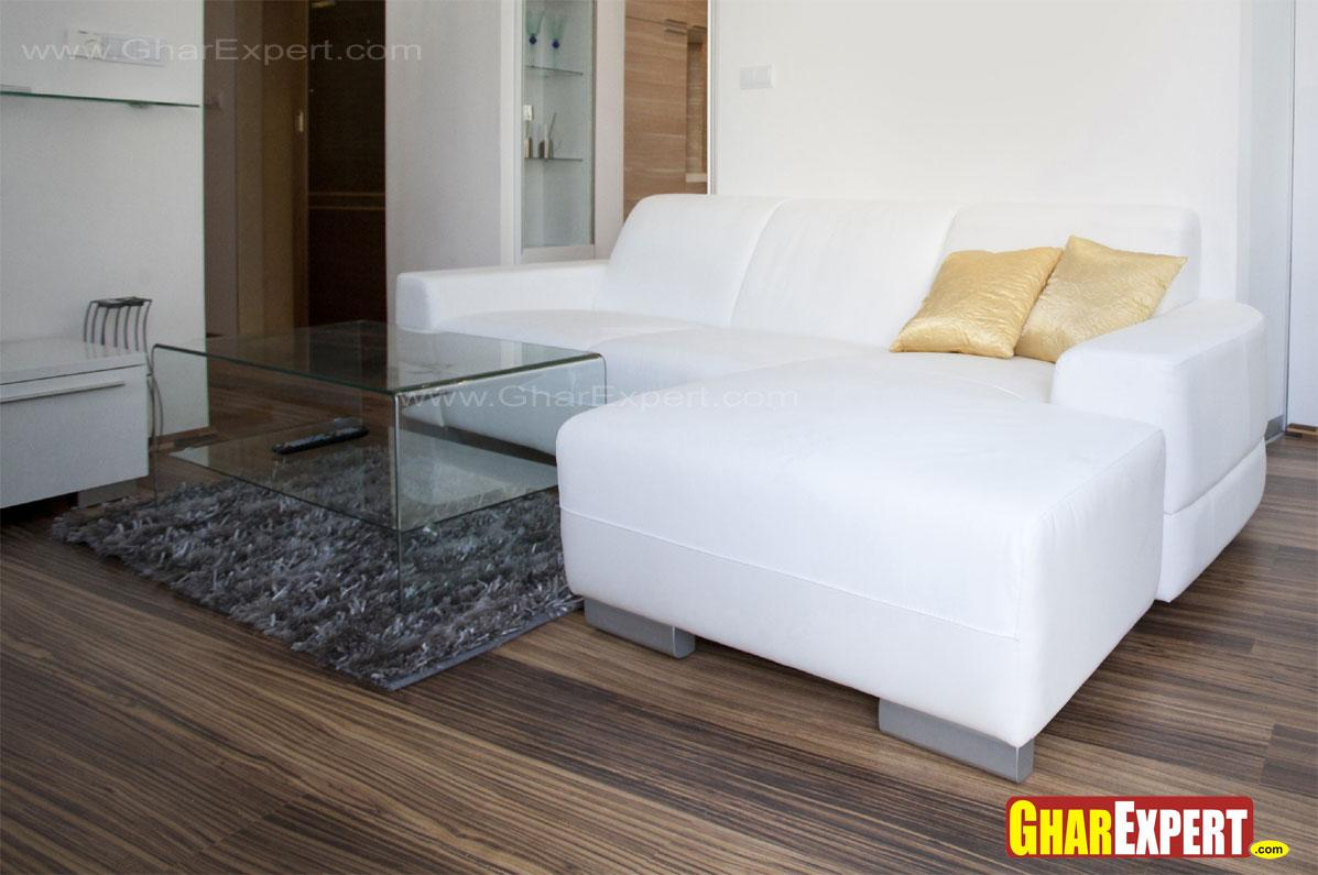 White upholstered sectional fo....